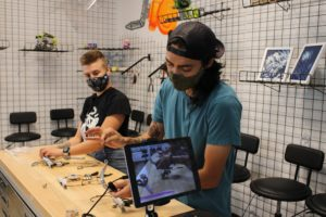 two bicas staff do an online art workshop